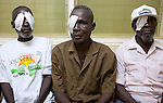 Patients wait in the recovery room of the Crystal Eye Clinic after a successful surgery to remove cataract.