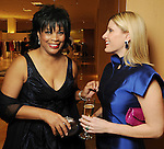 From left: Honorees Eileen Lawal talks with honoree Greggory Burk at the Houston Chronicle's Best Dressed announcement party at Neiman Marcus Tuesday Jan. 19,2010.(Dave Rossman/For the Chronicle)