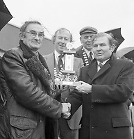 The St. Patrick's Day Parade makes its way down High Street and onto Main Street in 1978. Photo shows John O'Leary, TD, Grand Marshall with Peter Irwin, President, Killarney Chamber of Commerce  presenting a prize to a winner..Picture by Don MacMonagle .www.macmonagle.com