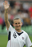 10 July 2005:   Tiffeny Milbrett of USA waves to the crowd after being called her name before the game against Ukraine at Merlo Field at University of Portland in Portland, Oregon.    USA defeated Ukraine, 7-0.   Credit: Michael Pimentel / ISI