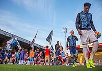 The teams head onto the pitch during the Sky Bet League 2 match between Wycombe Wanderers and Accrington Stanley at Adams Park, High Wycombe, England on 16 August 2016. Photo by Andy Rowland.