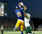 BROOKINGS, SD - SEPTEMBER 17: Jake Wieneke #19 from South Dakota State University hauls in a touchdown pass in front of Jerek Rosales #2 from Cal Poly in the second half of their game Saturday night at the Dana J. Dykhouse Stadium in Brookings. (Photo by Dave Eggen/Inertia)