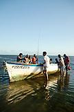 MAURITIUS, fishermen pull their rods and catch out of a boat after a day of fishing, Bel Ombre, Indian Ocean