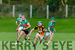 Tight marking in the Crotta O'Neills v Abbeydorney game in the 1st round of the North Kerry Hurling Championship, as Abbeydorneys Jack Sheehan in possession and breaks forward from Crotta's Jeaic McKenna and Eamonn Shanahan