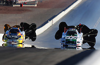 Apr. 13, 2008; Las Vegas, NV, USA: NHRA funny car driver Tim Wilkerson (left) after defeating Ashley Force during the SummitRacing.com Nationals at The Strip in Las Vegas. Mandatory Credit: Mark J. Rebilas-