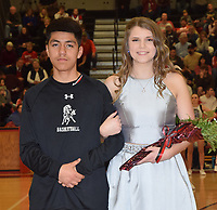 RICK PECK/SPECIAL TO MCDONALD COUNTY PRESS<br /> Sophomore queen attendant Erin Cooper is escorted by sophomore king attendant Irael Marcos.