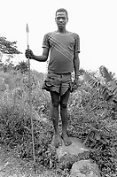 Ethiopia. South Omo Zone. Salamago district. Erka (little village in the mountains). Dime tribe lives in the mountains area. Man with his spear stands up on a rock. Permanently settled unless driven from their land by unsuspected attack of the neighbouring tribes Bodi and Mursi. The Dime are agriculturist. The Dime tribe is located in the Debub Omo Zone (South Omo Zone) of the Southern Nations, Nationalities and Peoples's région. © 2001 Didier Ruef
