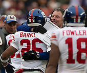 New York Giants head coach Pat Shurmur hugs New York Giants running back Saquon Barkley (26) after he scored on a 78 yard run in the second quarter against the Washington Redskins at FedEx Field in Landover, Maryland on Sunday, December 9, 2018.<br /> Credit: Ron Sachs / CNP<br /> (RESTRICTION: NO New York or New Jersey Newspapers or newspapers within a 75 mile radius of New York City)