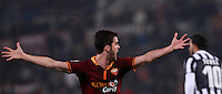 Calcio, quarti di finale di Coppa Italia: Roma vs Juventus. Roma, stadio Olimpico, 21 gennaio 2014.<br /> AS Roma midfielder Miralem Pjanic, of Bosnia, reacts during the Italian Cup round of eight final football match between AS Roma and Juventus, at Rome's Olympic stadium, 21 January 2014.<br /> UPDATE IMAGES PRESS/Isabella Bonotto