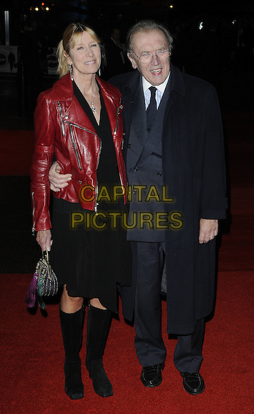 LADY CARINA FROST & SIR DAVID FROST .attending the European Premiere of 'Harry Brown' at the Odeon Leicester Square, London, England, UK, November 10th 2009. .full length red leather jacket black dress knee high boots coat suit tie couple married wife husband arm around waist bag gold .CAP/CAN.©Can Nguyen/Capital Pictures