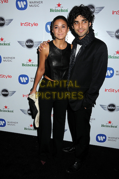 Emmanuelle Chriqui & guest.Warner Music Group 2013 Grammy Celebration held at The Chateau Marmont, West Hollywood, California, USA..February 10th, 2013.full length black sleeveless leather top trousers scarf suit.CAP/ADM/BP.©Byron Purvis/AdMedia/Capital Pictures.