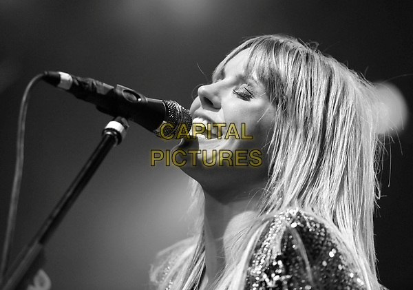 GRACE POTTER of Grace Potter and The Nocturnals .performs live at The El Rey Theatre in Los Angeles, California, USA, .February 4th 2011..music concert gig on stage portrait headshot beaded black and white   microphone   singing fringe  eyes shut closed    profile                                                  .CAP/RKE/DVS.©DVS/RockinExposures/Capital Pictures.
