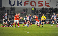 Sale Sharks Ross Harrison with the ball tackled by Saracens No 5 George Kruis during the European Rugby Champions Cup match between Sale Sharks and Saracens at AJ Bell Stadium, Salford, England on 18 December 2016. Photo by Paul Bell.