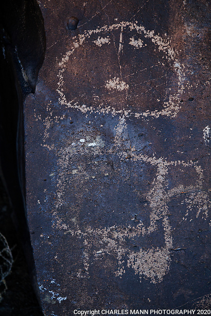 Hundreds of ancient petroglyphs can be seen near the Santa Fe River in Santa Fe County, New Mexico.