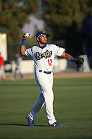 Jose Brizuela (12) of the Rancho Cucamonga Quakes throws in the outfield before a game against the Stockton Ports at LoanMart Field on August 15, 2017 in Rancho Cucamonga California. Rancho Cucamonga defeated Stockton, 11-9. (Larry Goren/Four Seam Images)