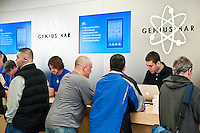 Customers explore the iPad 2 in an Apple store on launch day, Cherry Hill Mall, NJ, USA. March 11, 2011