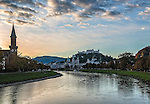 A sunrise over the Salzach River reveals the beautiful city of Salzburg, Austria in the gathering light of dawn.