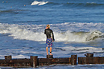 Surfer in Folly Beach SC Checking out the surf