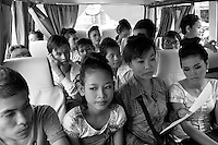 Children of Bassac. The troup on the bus heading for a restaurant in Phnom Penh where the dancers will perform. Nop Thyda, in the middle of her students, was used to dance in front of the Cambodian King, Foreign government or diplomatic delegation. « At this time, she says in a bitter way, we danced in front of people watching us. Nowadays, my students dance before people eating ». Phnom Penh, Cambodia -2007