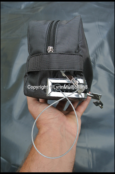 BNPS.co.uk (01202 558833)<br /> Pic: LynnMulholland/BNPS<br /> <br /> ***Please Use Full Byline***<br /> <br /> A revolutionary new bag has been invented to solve the age-old problem of where to keep your valuables while at the beach.<br /> <br /> The special hold-all has been created with a cord running through the zip which can be attached to a deck chair, sun lounger or seaside umbrella.<br /> <br /> The only way the zip and cord can be untied is by tapping in a personalised combination code, similar to that found on a padlock or briefcase.<br /> <br /> The bag also has a high-tech alarm system so that if it someone attempts to move it from where it is left, a piercing alarm will ring out and alert the owner to the thief.<br /> <br /> The clever device, dubbed the Clam Bag, is currently funding on crowd-sourcing website Kickstarter.