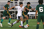 WATERBURY  CT. - 14 October 2019-101419SV14- #10 Ahmed Aljamal and #2 Kevin Matiz of Holy Cross High battle for the ball during NVL Soccer action in Waterbury Monday.<br />Steven Valenti Republican-American