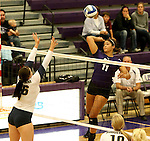SIOUX FALLS, SD - SEPTEMBER 19:  Lexi Scott #11 from the University of Sioux Falls winds up for a kill attempt past Ivy Pearson #16 from Augustana during their match Saturday afternoon at the Stewart Center. (Photo by Dave Eggen/Inertia)
