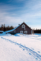 """Solberget, Jokkmokk, Swedish Lapland, Sweden, March 2013. Dirk and Silke Hagenbusch live their lives in a wilderness retreat  called 'Solberget'. It is situated directly on the Arctic Circle, near the nature reserves """"Granlandet"""", """"Päivavuoma"""" and """"Pellokiellas"""", and close to the """"Muddus"""" National Park. Here, nature can be experienced in its purest form – far away from civilisation. As an authentic wilderness farm, Solberget is neither connected to public electricity nor to the mains water supply. Water comes from a spring in the woods and is delicious! Oil lamps and the natural warmth of wood burning stoves provides a soft and cosy atmosphere, even with biting frost outside. Photo by Frits Meyst/Adventure4ever.com"""