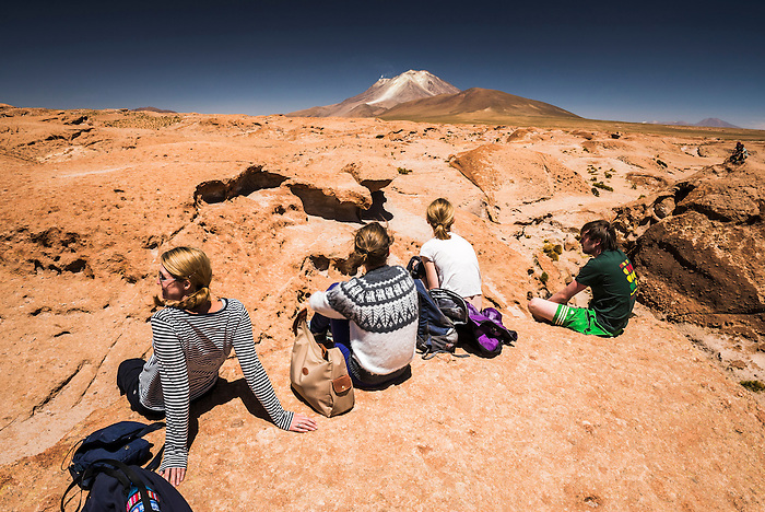 Tourists at Chiguana Desert, part of a 3 day tour across the Altiplano of Bolivia