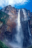 793050020 clouds form above ayuan tepui the source of  angel falls the tallest waterfall in the world as the water flows over the edge of the tepui and drops over 2000 feet in canaima national park venezuela