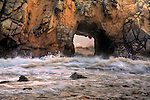 Close up of waves and sea spray through a sea arch at Pfeiffer Beach in Big Sur, California, USA. The rocks are part of the Tufoni Formation.