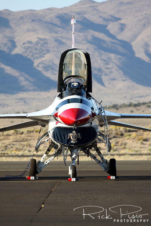 A United States Air Force Thunderbirds F-16 Fighting Falcon sits on the ramp prior to a flight demonstration during the 2008 Reno National Championship Air Races at Stead Field in Nevada. The Thunderbirds were formed in 1956 and have been flying the F-16C Fighting Falcon since 1992.