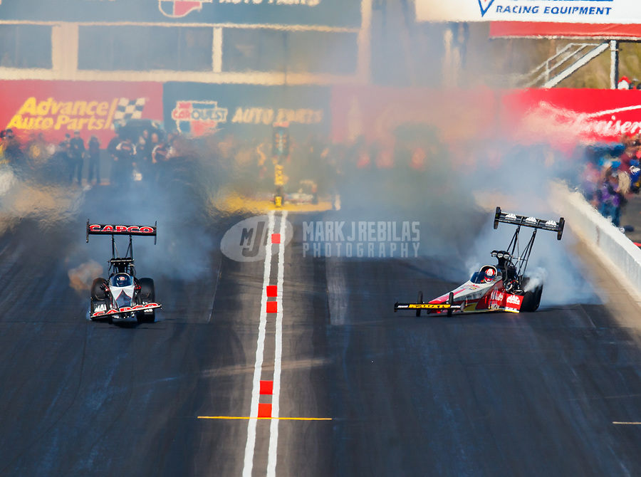Feb 25, 2018; Chandler, AZ, USA; NHRA top fuel driver Billy Torrence (left) races alongside Doug Kalitta during the Arizona Nationals at Wild Horse Pass Motorsports Park. Mandatory Credit: Mark J. Rebilas-USA TODAY Sports