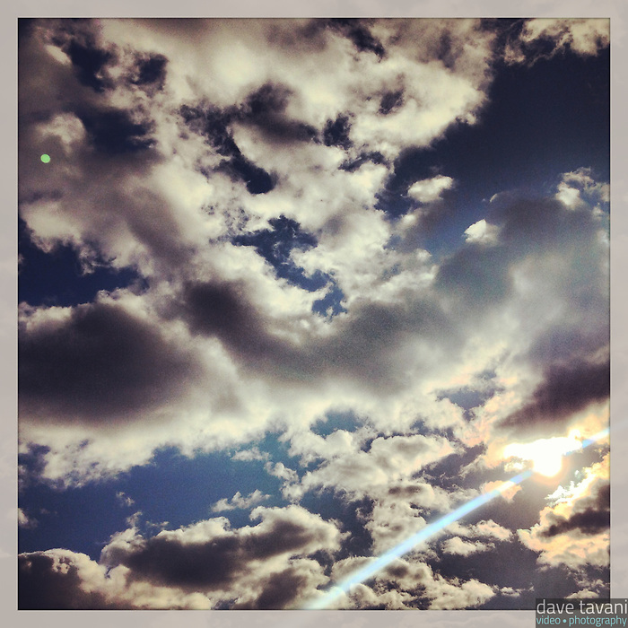 The clouds break for an instant to let the sun shine through on December 22, 2012.