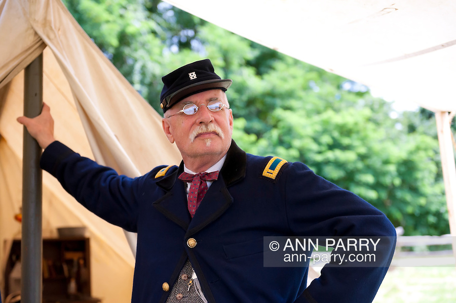 Old Bethpage, New York, USA - July 21, 2012: GUY SMITH of Huntington, NY, portrays Regimental Adjutant at re-creation of Camp Scott, a Union Army training camp, at Old Bethpage Village Restoration, to commemorate 150th Anniversary of American Civil War.