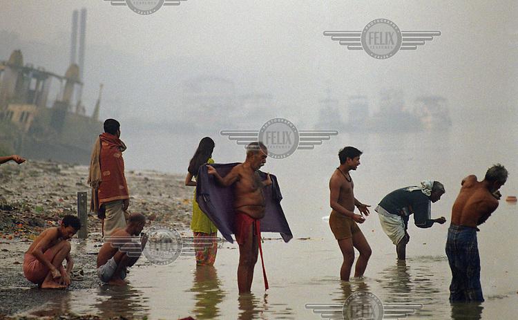 Pilgrims bathe at Fairlie Ghat. ..