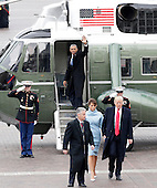 Former President of the United States Barack Obama waves from a helicopter as newly elected United States President Donald Trump walks with wife Melania Trump back to the Capitol Building after Trump is sworn in at the 58th Presidential Inauguration on Capitol Hill in Washington, D.C. on January 20, 2017.   <br /> Credit: John Angelillo / Pool via CNP