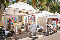 Artist Thom Millsap chats with shoppers during the Naples Art Association's annual Art in the Park at The von Liebig Art Center, Naples, Florida, USA, Dec. 1, 2012. Photo by Debi Pittman Wilkey