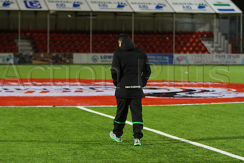26.02.2016. New Douglas Park, Hamilton, Scotland. Scottish Premier League. Hamilton Academicals versus Celtic. Celtic assistant manager John Collins inspects the artificial pitch surface