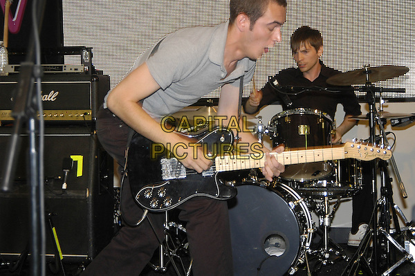 EDITORS.Play Free Gig at Instore Signing Session , HMV 150 Oxford Street, London, July 13th 2005..half length band playing guitar concert drums drummer.Ref: HT.www.capitalpictures.com.sales@capitalpictures.com.©Hugh Thompson/Capital Pictures