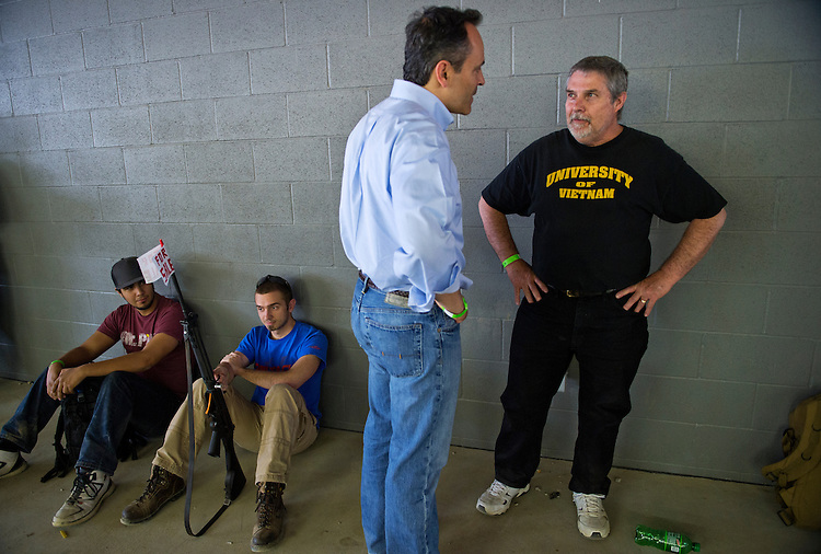 UNITED STATES - APRIL 12: Matt Bevin, republican Senate candidate in for Kentucky, talks with Michael Keen, a Vietnam vet from Indiana, at the Knob Creek Gun Range Machine Gun Shoot Out in West Point, Ky. (Photo By Tom Williams/CQ Roll Call)