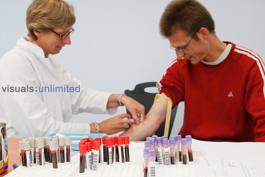 Nurse conducting blood test on patient, Lille Institut Pasteur, France