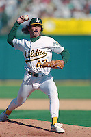 OAKLAND, CA - Dennis Eckersley of the Oakland Athletics pitches during Game 4 of the American League Championship Series against the Toronto Blue Jays at the Oakland Coliseum in Oakland, California in 1992. Photo by Brad Mangin