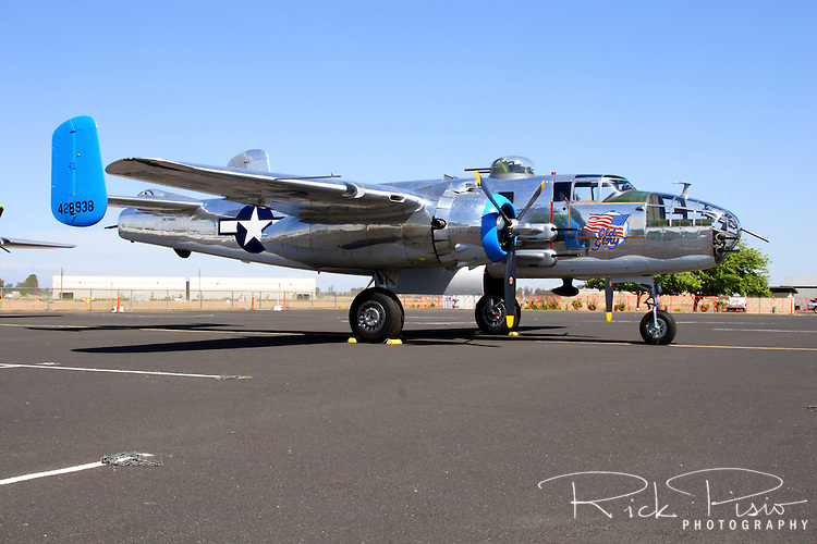 A North American B-25 Mitchell bomber sits on the ramp at Madera Airport in California.