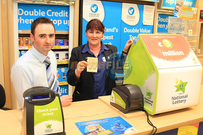 Tesco Navan winning lottery ticket being given to charity, Store Manager Marty Geraghty with Caroline Cunningham.Picture: Fran Caffrey / www.newsfile.ie.