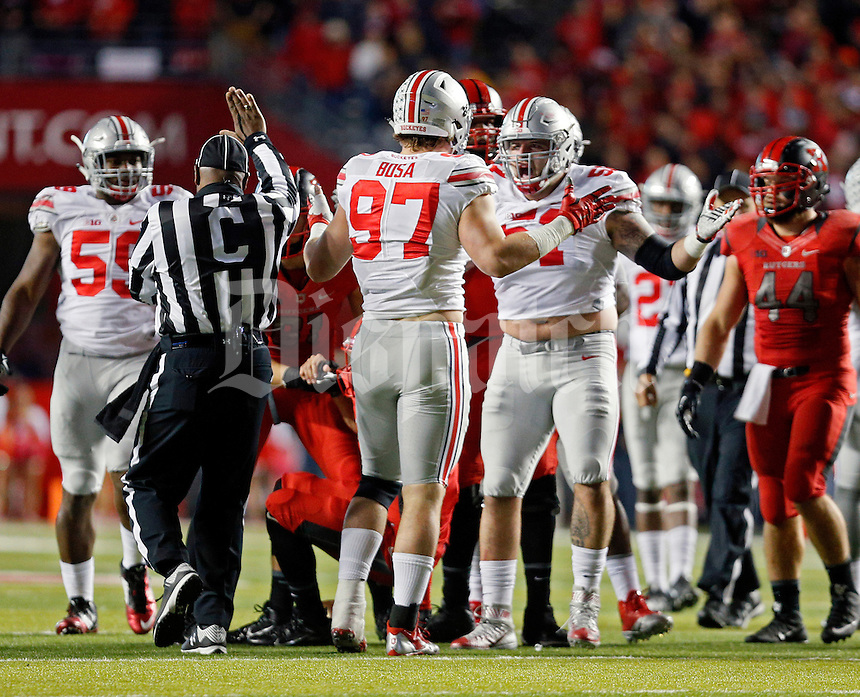 Ohio State Buckeyes defensive lineman Joey Bosa (97) and Ohio State Buckeyes defensive lineman Joel Hale (51) celebrates a sack against Rutgers Scarlet Knights in the first half at High Point Solutions Stadium on October 24, 2015.  (Dispatch photo by Kyle Robertson)