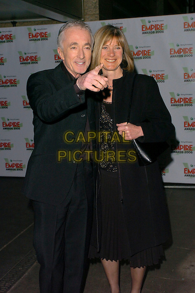 ANTHONY DANIELS & GUEST.Sony Ericsson Empire Film Awards 2006 at Hilton London Metropole, London, UK..March 13th, 2006.Ref: CAN.half length black jacket coat pointing gesture.www.capitalpictures.com.sales@capitalpictures.com.©Capital Pictures