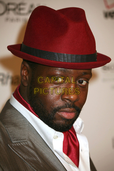 WYCLEF JEAN.Clive Davis 2007 Pre-Grammy Awards Party at the Beverly Hilton Hotel, Beverly Hills, USA..February 10th, 2007.headshot portrait red hat burgundy beard facial hair scarf .CAP/ADM/BP.©Byron Purvis/AdMedia/Capital Pictures