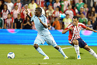 Sporting KC forward C.J Sapong goes past Chivas Guadalajara defender Mario de Luna... Sporting Kansas City played Chivas Guadalajara to a 2-2 tie at LIVESTRONG Sporting Park, Kansas City, Kansas in an international friendly.