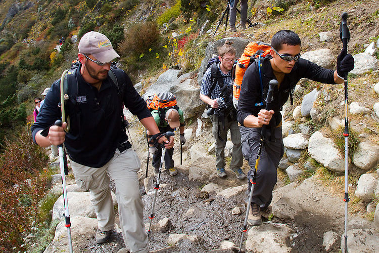 Ike Isaacson guiding blind soldier Steve Baskis through the rocks along the trail to base camp. Photo by Didrik Johnck.