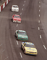 Dale Earnhardt leads a line of cars at Darlington enroute to victory in the Southern 500 in September 1987.(Photo by Brian Cleary)
